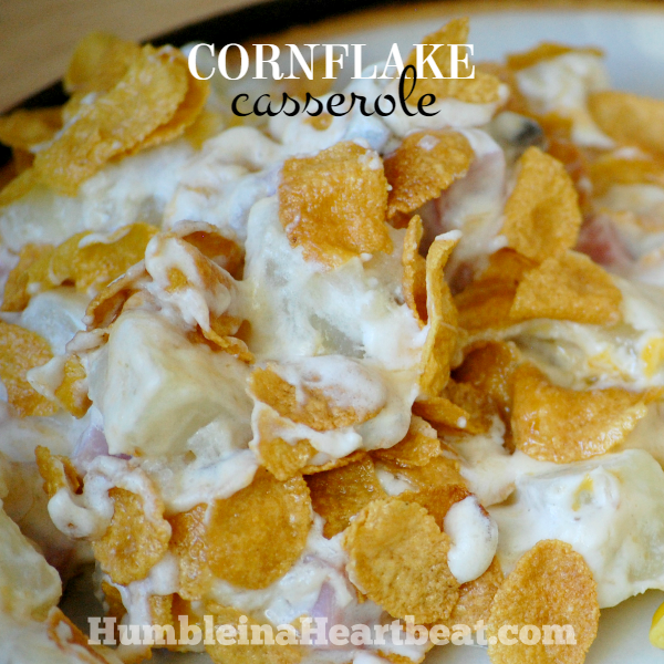 Cornflake Casserole is the ultimate comfort food. Potatoes, cheese, ham, sour cream, cornflakes. What's not to love?