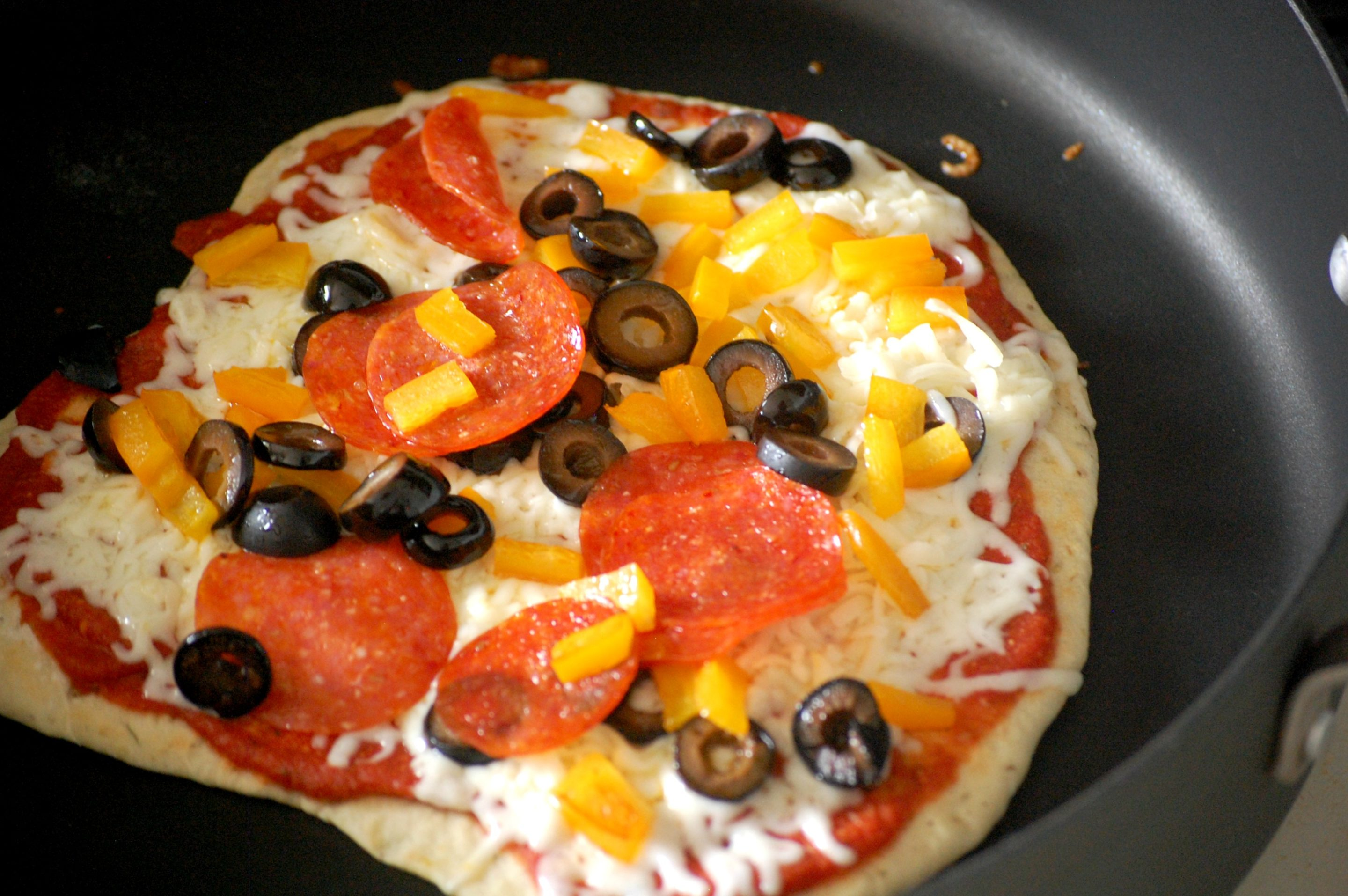 Don't turn on the oven to make pizza this summer! Use a skillet instead, and get some of the best pizza you've ever had in under an hour.