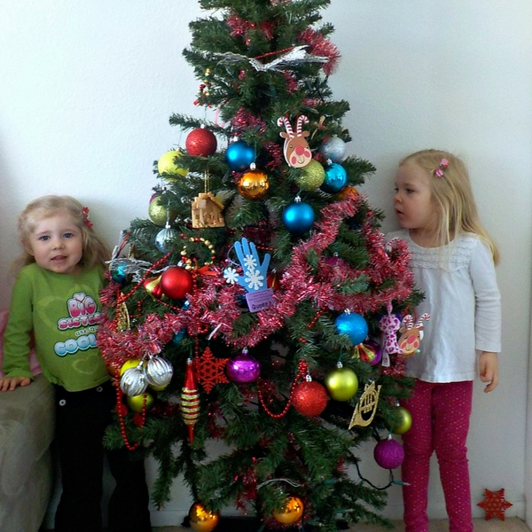 """I am perfectly happy letting my toddlers decorate our Christmas tree. It may not be """"Pinterest-worthy,"""" but it screams love, peace, and joy to me."""