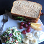 BLTA Sandwiches with fresh fruit and salad