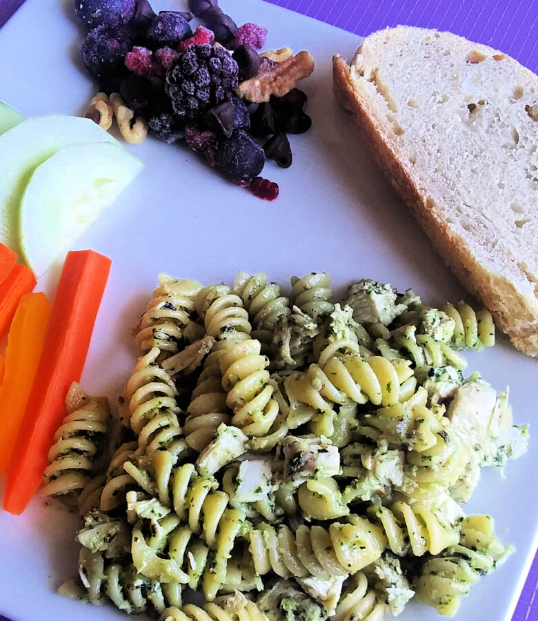 Quick and easy meals: pesto pasta with chicken, artisan bread, veggies and dip, and a berry nutty chocolate treat